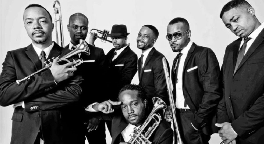 The brothers of Hypnotic Brass Ensemble with their instruments