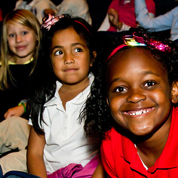 smiling children in TPAC's Polk Theater
