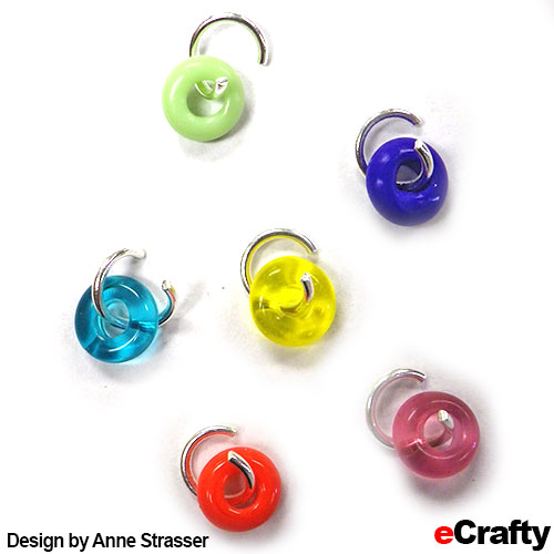 Start by looping SKU 1519 glass donut beads onto opened 1501K or 1501U jump rings