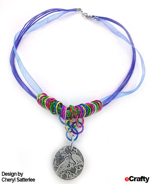 Made with eCrafty.com organza cord, 12mm rainbow jump rings, pendant
