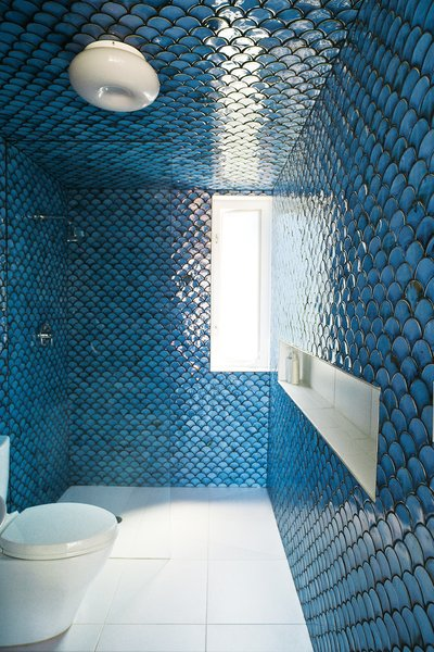 In the upper-level bathroom, tiles painstakingly fired by DeSimio cover the walls and ceiling.