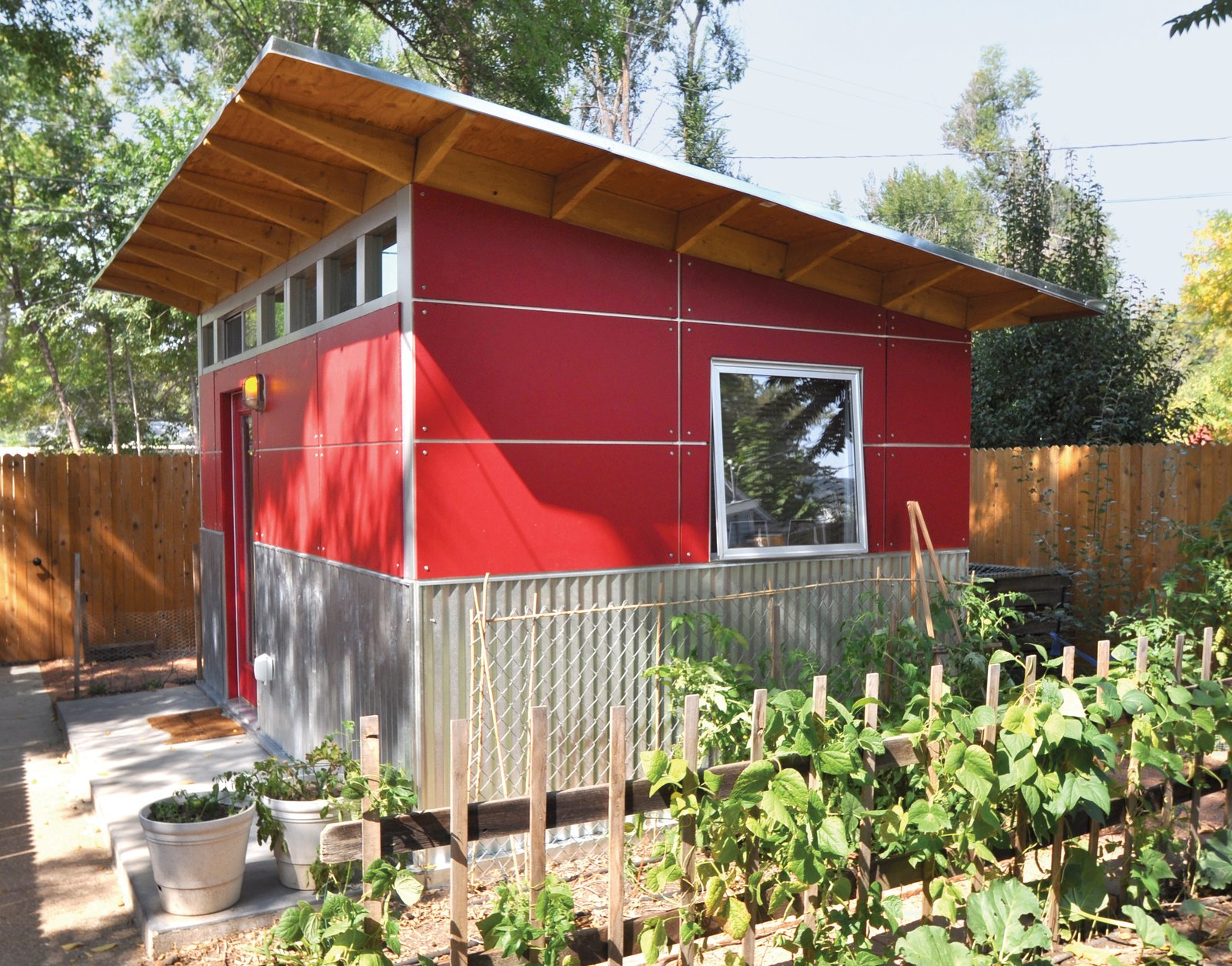 A Prefab Shed That Provides Refuge For Work And Play