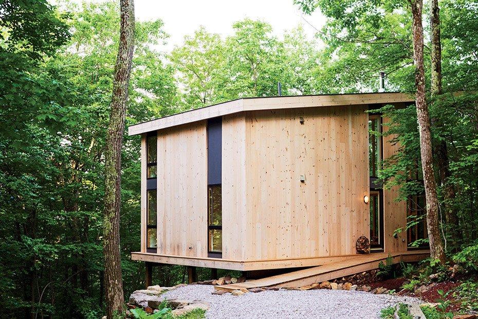 10 maisons en porte-à-faux qui détruisent la gravité - Photo 21 sur 23 - Ces coûts ont été partiellement récupérés en utilisant des planches de pin nouées pour l'extérieur.