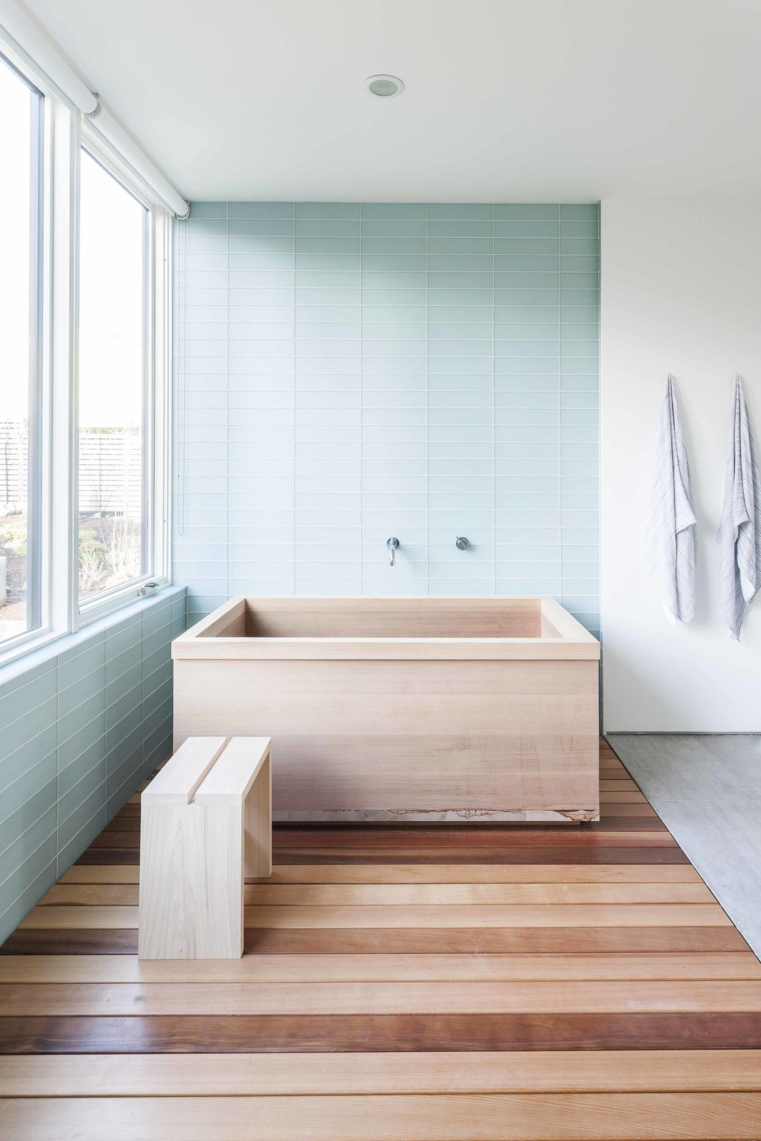 The custom cedar tub, fabricated by Dovetail, elegantly fits into this master bathroom.