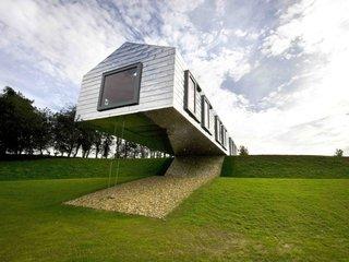 10 maisons en porte-à-faux par gravité - Photo 4 de 23 -