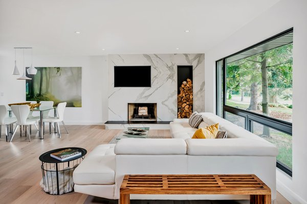 Modern home with Living Room, Wood Burning Fireplace, and Light Hardwood Floor. Photo 3 of Modern Renovation