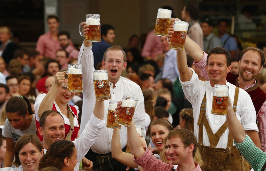 Prost  Millions cheer with beer at Oktoberfest in Munich   PBS NewsHour Visitors cheer with beer during the opening ceremony for the 182nd  Oktoberfest in Munich  Germany