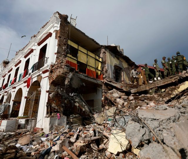 Soldiers Remove The Debris Of A House Destroyed In An Earthquake That Struck Off The Southern