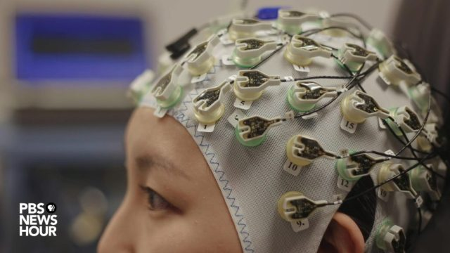 Luana Colloca's lab at the University of Maryland, Baltimore uses electroencephalography (pictured) and functional magnetic resonance imaging (fMRI) to study how placebos influence pain relief. Photo by Matt Ehrichs