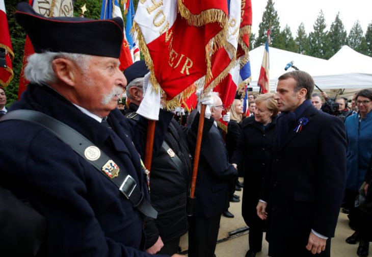 French President Emmanuel Macron and German Chancellor Angela Merkel meet with veterans at the Clairiere of Rethondes, during a commemoration ceremony for Armistice Day, 100 years after the end of the First World War, in Compiegne, France, November 10, 2018. Photo by Philippe Wojazer/Pool via Reuters