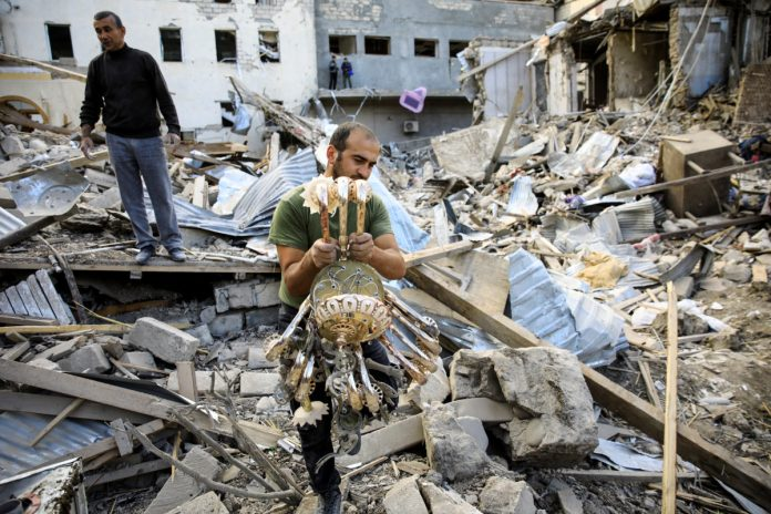 Armenia, Azerbaijan report attacks despite cease-fire deal | PBS NewsHour