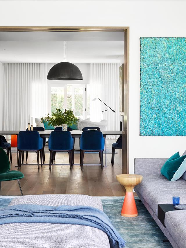 "interior designer Lisa Burdus, starting point in every room of this [contemporary home](https://www.homestolove.com.au/postwar-bungalow-turned-contemporary-family-home-21021|target=""_blank"") was the owners' artworks. ""They have a large collection of Indigenous art. We decided where to hang each piece, and then used the artworks for colour cues,"" says Lisa. The tones are repeated in custom-designed rugs, with further pops of colour in the accessories. Artwork by Barbara Weir."