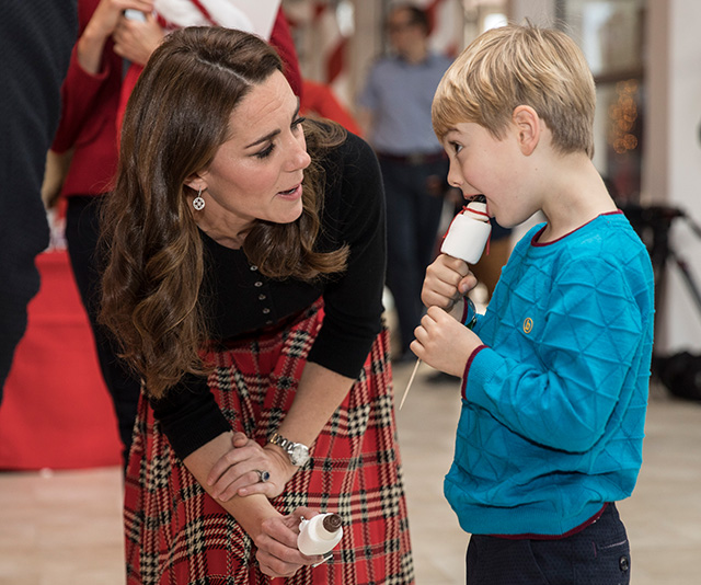 Always a natural with kids, Kate had many animated discussions with the young guests at the event. (Image: Getty)