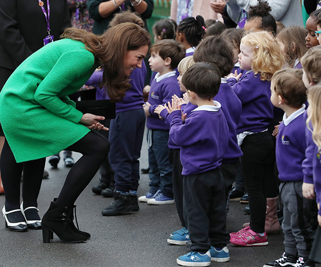 The duchess doesn't just use the technique with her own children. You'll see her kneeling down to talk all children she greets. (Image: Getty)