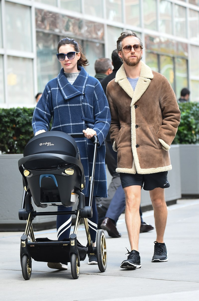 Anne Hathaway out and about with her son Jonathan and husband Adam Shulman. (Image: Getty)