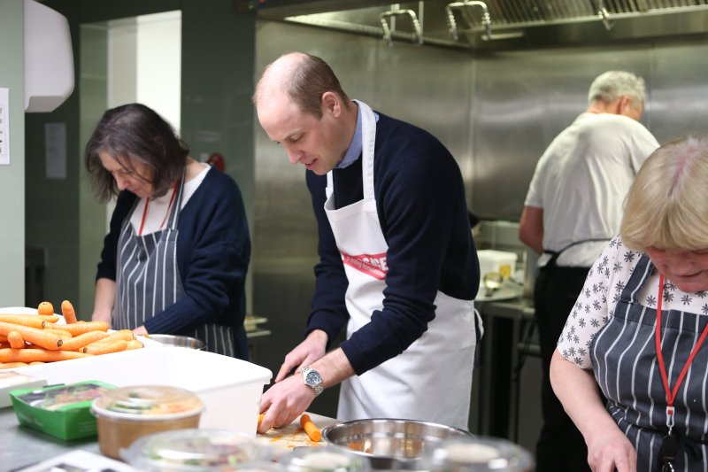 Prince William helped out in the kitchen at The Passage, helping the head chef make spaghetti bolognese. (Image: Getty)