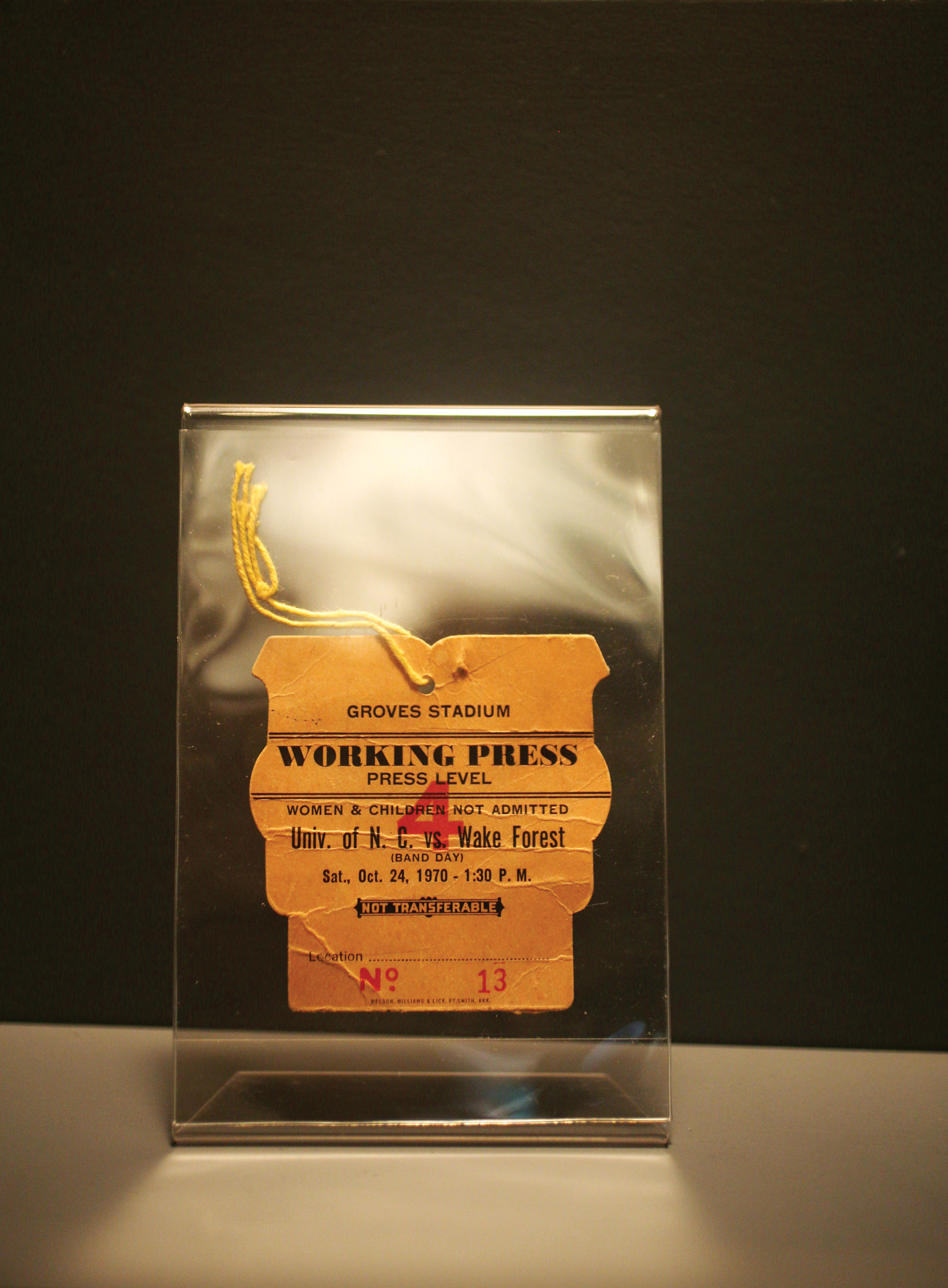 """Mary Garber's press badge from 1970 reads, """"women & children not admitted""""."""