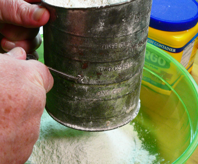 To make the Cake Flour, sift the flour into the mixing bowl. That's one time completed.