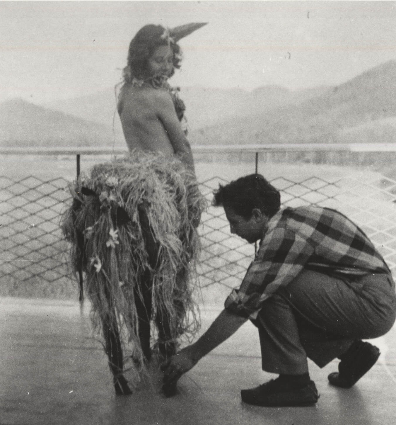 Black Mountain College students followed a variety of creative pursuits on campus and beyond. From left to right: Robert Rauschenberg makes the final adjustments on a centaur costume and Josef Albers guides a student during drawing class.