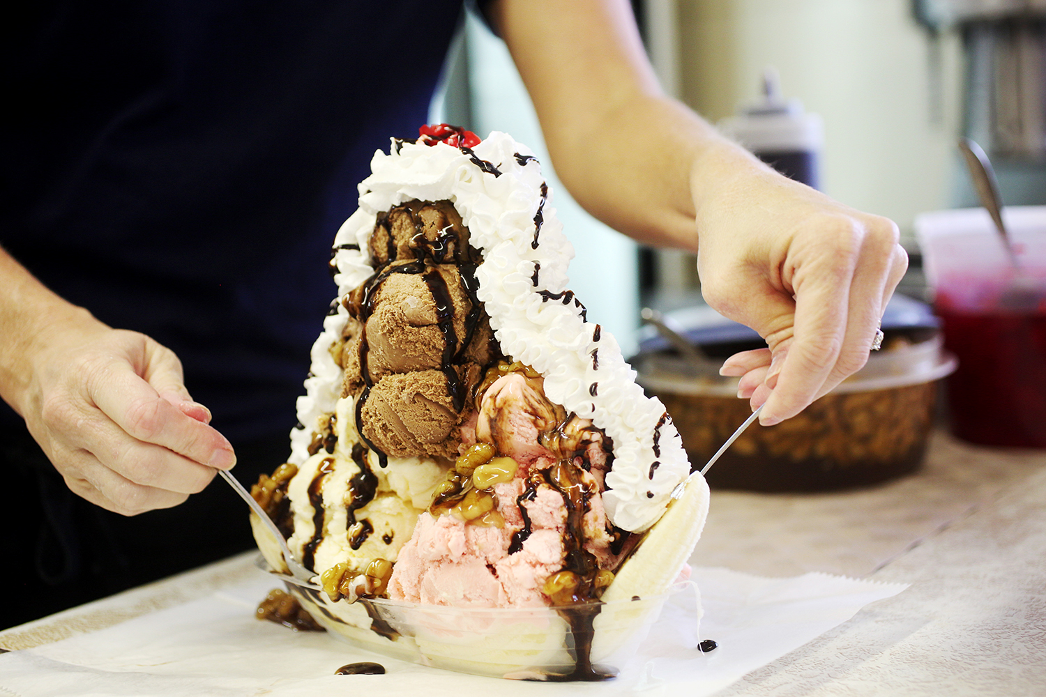 Though the old Dairy Center is now the Bar-B-Q Center, ice cream is still part of the experience. In fact, the banana split alone is enough to feed a family.