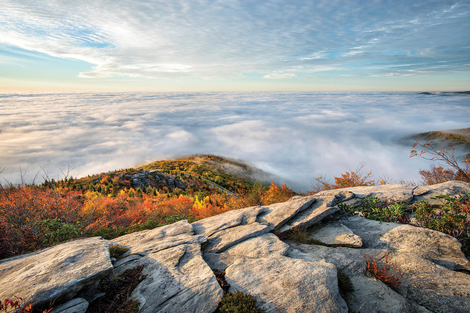 From this vantage point, the Blue Ridge Parkway is a mere thread. Photograph by Tommy White