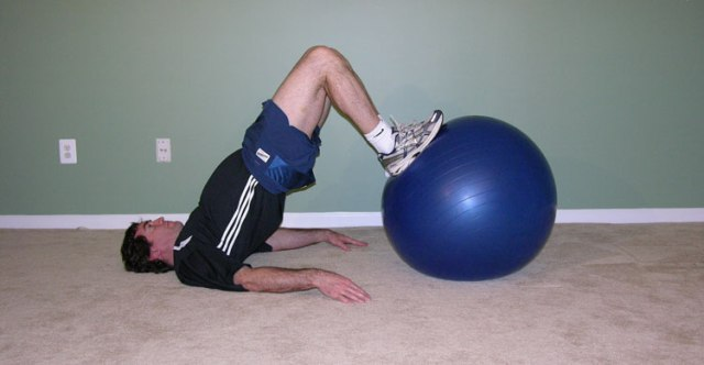 leg curl with exercise ball