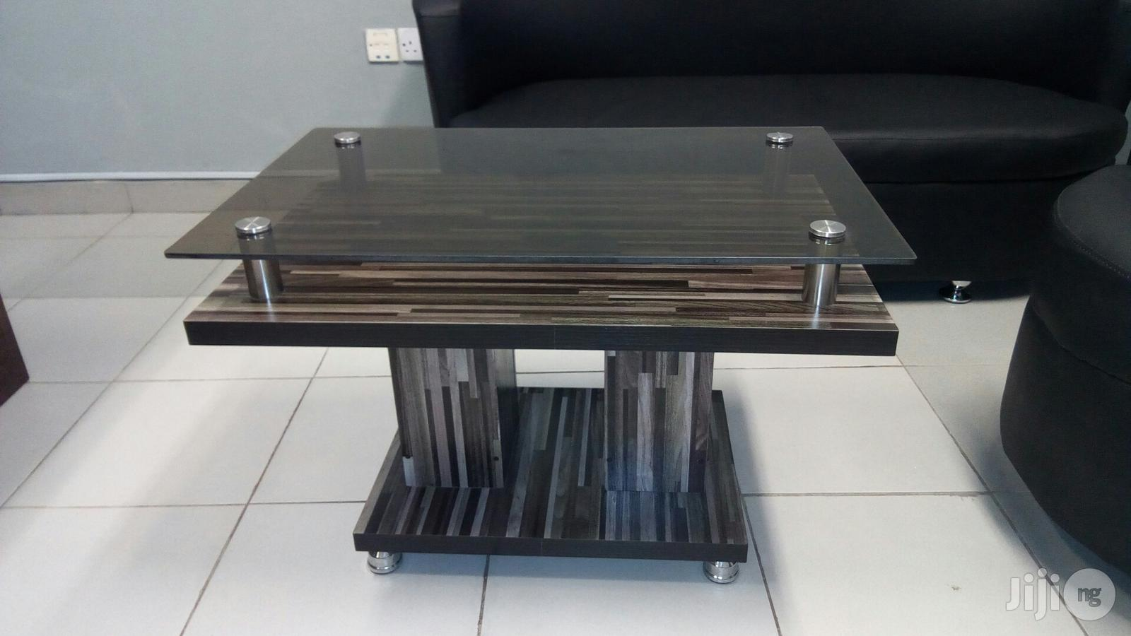 brand new wooden center table with glass top