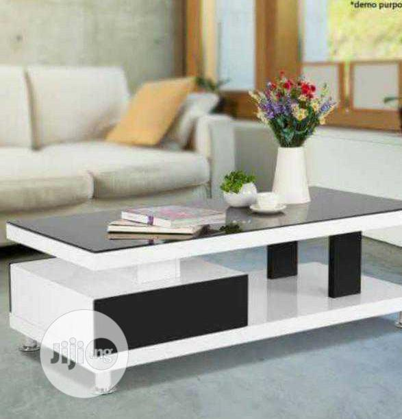 modern hdf white center table with glass top