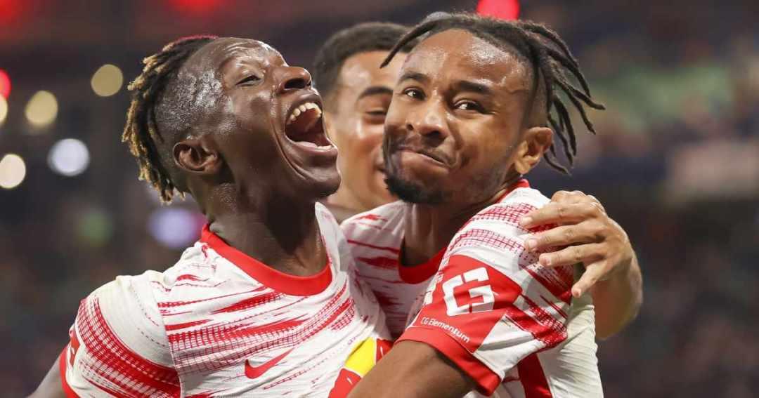 Amadou Haidara and Christopher Nkunku celebrate for RB Leipzig