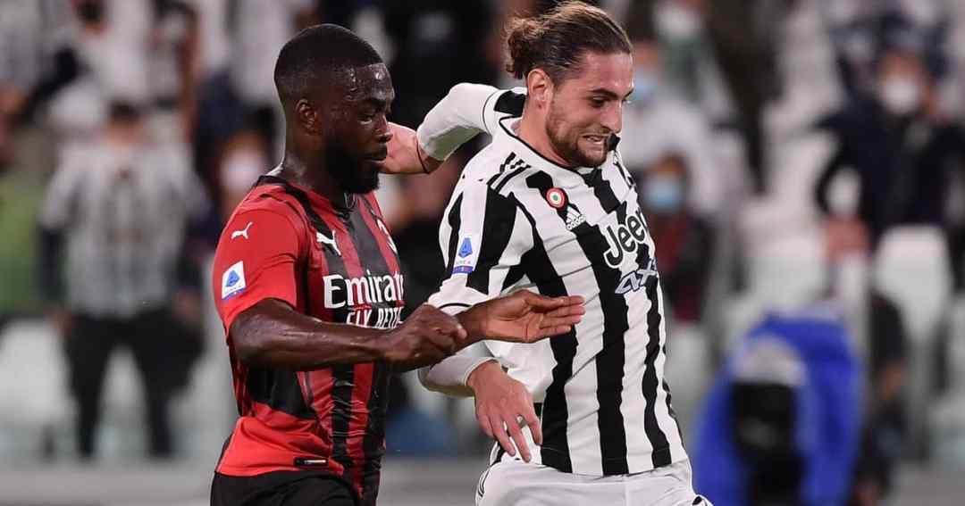 Fikayo Tomori and Adrien Rabiot battle for possession in AC Milan vs Juventus, September 2021