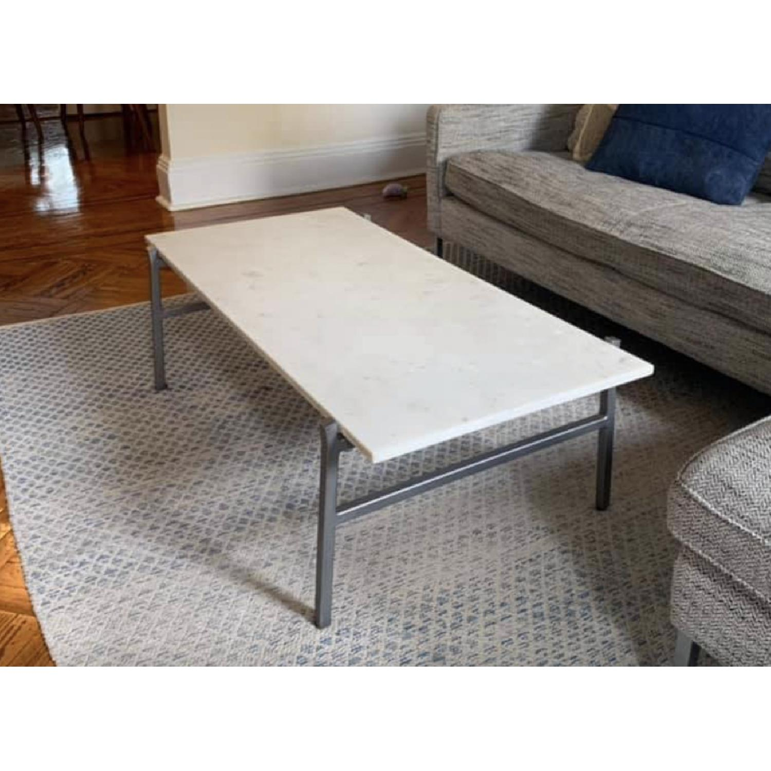 cb2 slab small marble coffee table w antiqued silver base