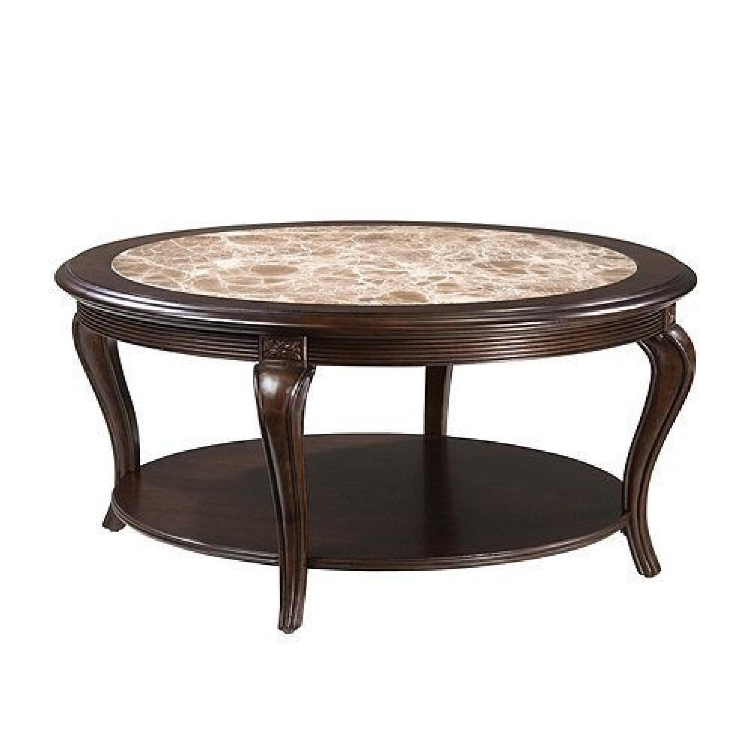 raymour flanigan round marble top cherry wood coffee table