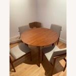 West Elm Mid Century Round Expandable Dining Table Aptdeco