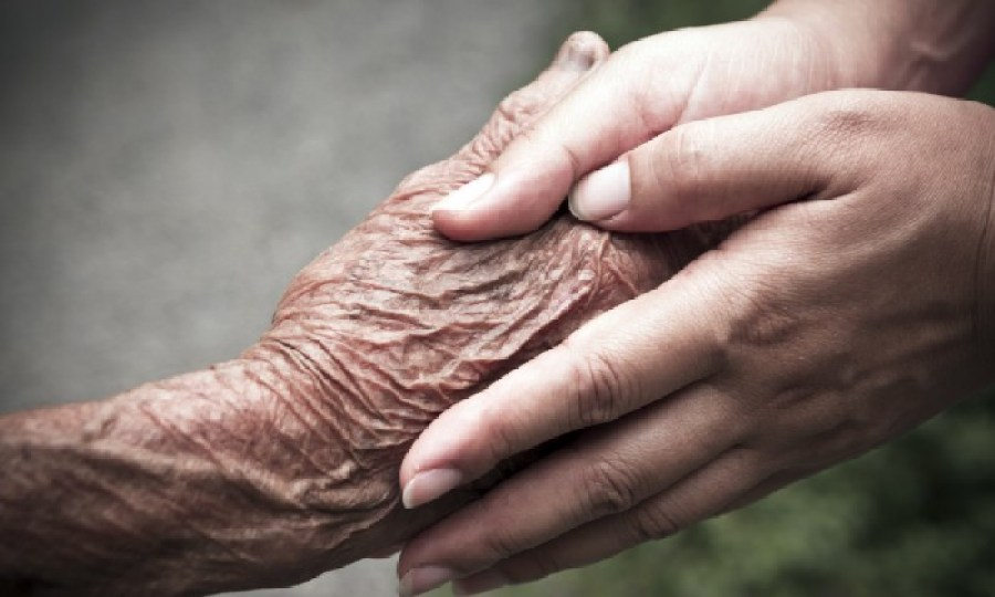 Holding hand of aging parent