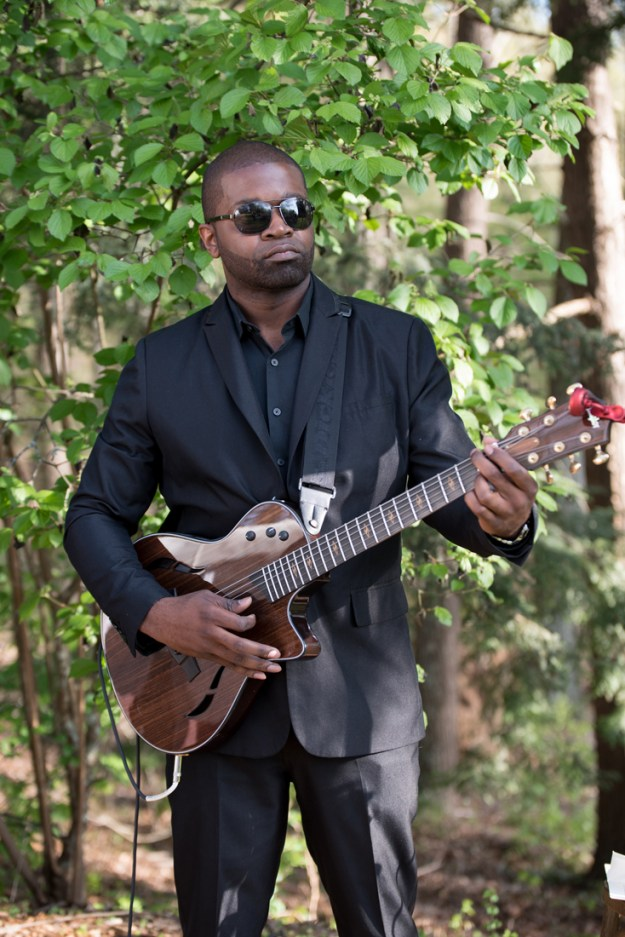 Guitarist for Sol Fusion playing outside wedding ceremony