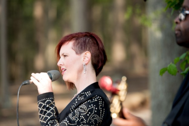 Vocalist for Sol Fusion band singing outside during wedding ceremony