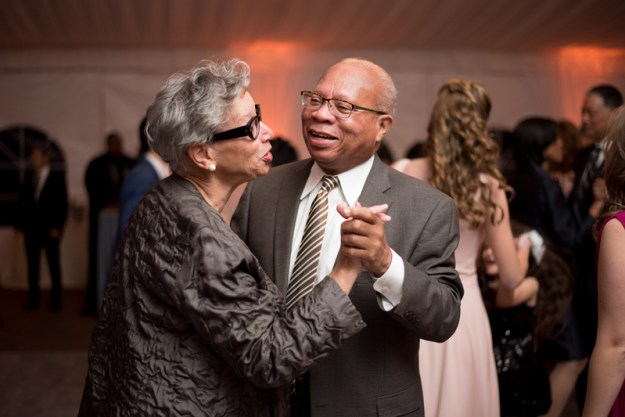 Older couple dancing at wedding reception.