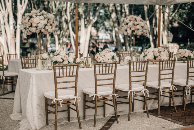 Luxe pink and gold long table at wedding reception