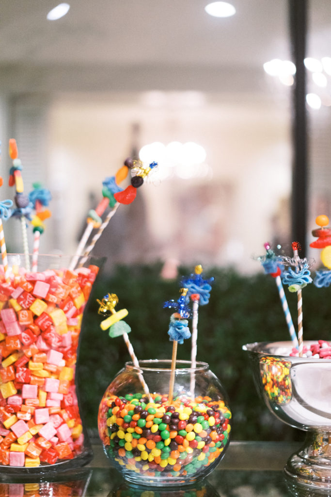 Candy display in glass jars during New Orleans wedding
