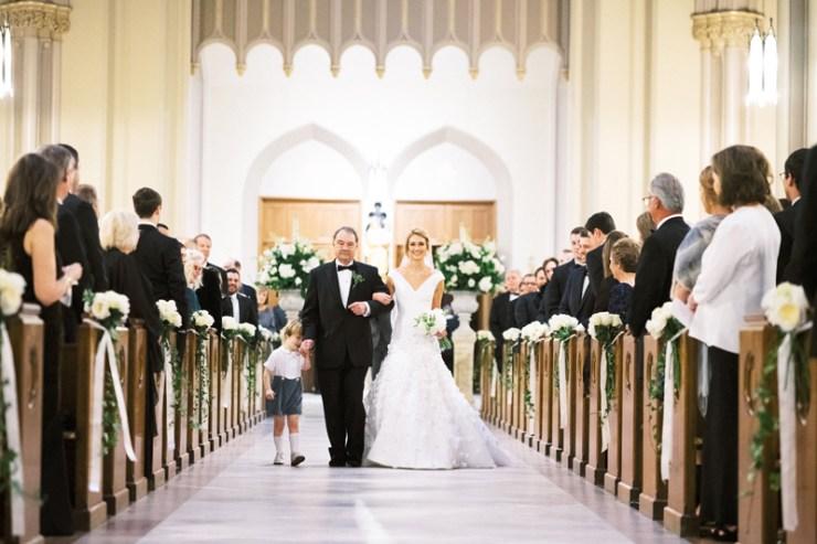Bride escorted down aisle during Nola wedding