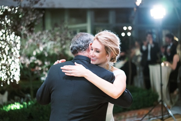 Father and daughter dancing during wedding reception