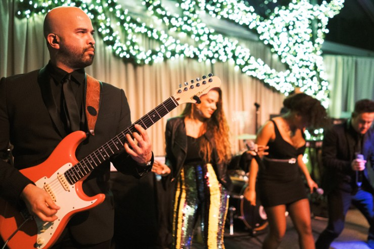Wedding band, Powerhouse, performing at tented receptions in New Orleans.