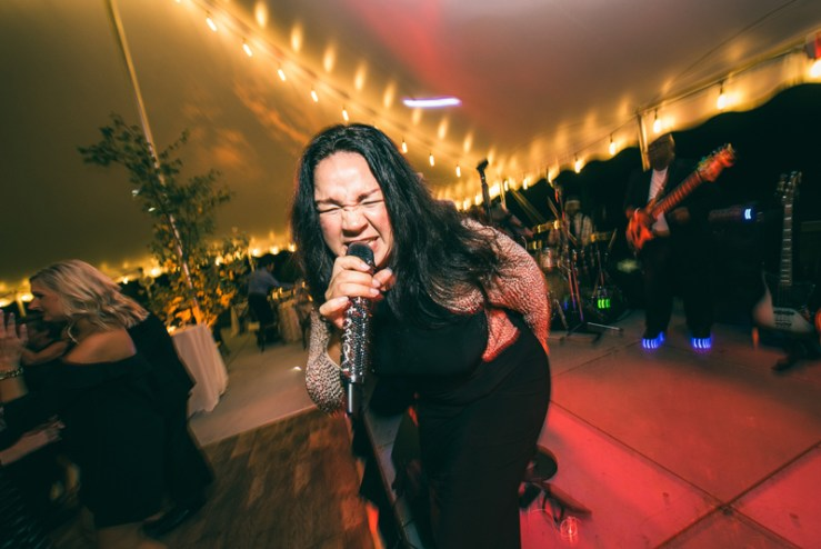 Right to Party band lead vocalist singing at Summerfield Farms wedding reception.