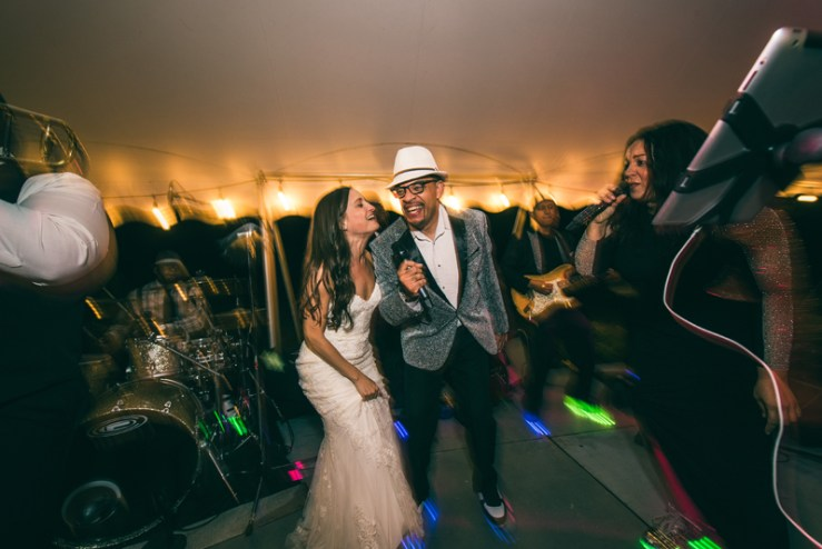 Bride singing on stage with Right to Party band at Summerfield Farms wedding.