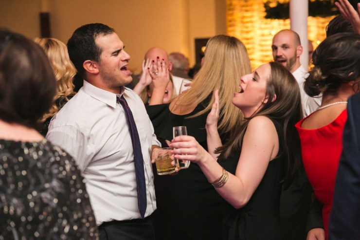 Guests singing and dancing during wedding reception at The Stave Room.
