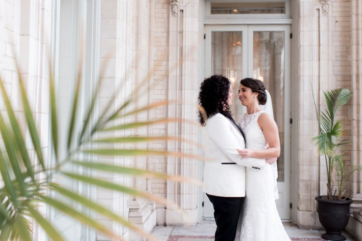 Two brides posing during their The Jefferson Hotel wedding.