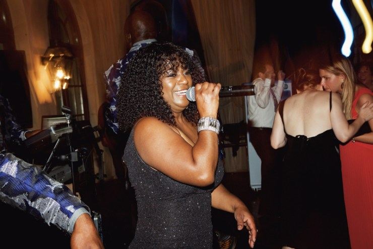Female vocalist of Loose Chain band performing for wedding guests at Dahlonega, GA wedding.