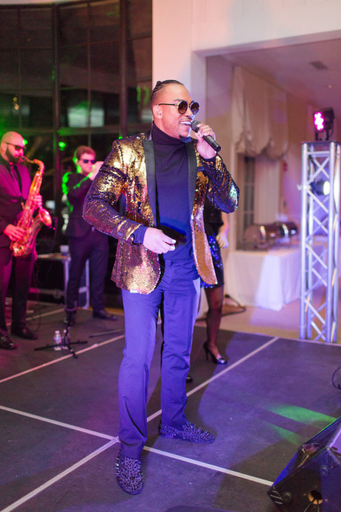 Male vocalist from The Royals band performing on stage during Kiawah Island Club wedding reception.
