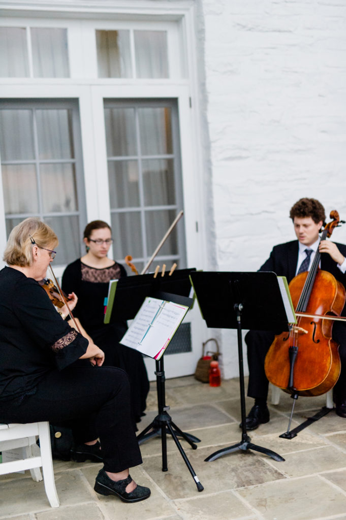 String musicians playing during ceremony at Roaring Gap Club.