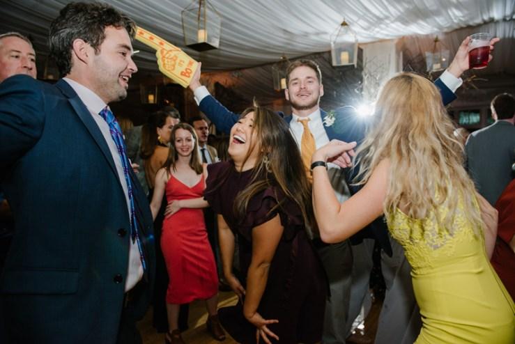 Crowded dance floor at Roaring Gap Club wedding reception.
